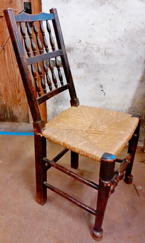 Damaged antique chair